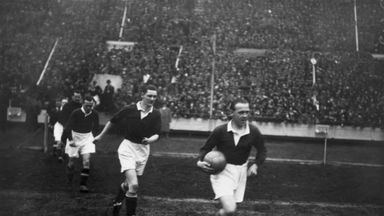 The Scottish captain Jimmy McMullan leads out his team before Scotland's famous Wembley win in 1928