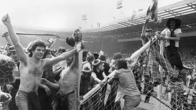 Scottish football fans, known as the Tartan Army, invading the pitch and pulling down goalposts after Scotland beat England 2-1 at Wembley Stadium