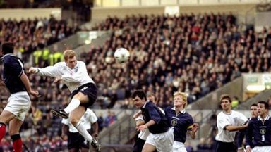 Paul Scholes heads in for England against Scotland in 1999